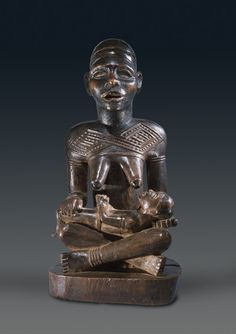 Yombe Maternity phemba Attributed to the Master of the De Briey Maternity Kongo peoples, Yombe sub-group, Democratic Republic of the Congo Wood Height: 29.5 cm