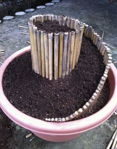 Spiral planter - Use bamboo to make the spiral.  Plant arid plants on top and moisture-loving plants at the bottom.