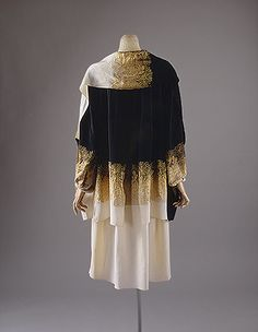 """Evening coat, ca. 1927 Gabrielle """"Coco"""" Chanel (French, 1883–1971) Silk, metallic thread. The convergence of Art Deco line, the modernist impulse to facilitate pure form, and japonisme's potential to offer a vocabulary of untailored wrapping shapes was more than fortuitous. Chanel uses a French ombré textile with pattern sources from the Japanese kimono, but brings to it the ethos of chaste minim..."""