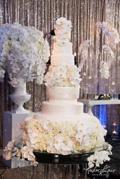 All white extravagant and elegant wedding cake with fresh floral decor