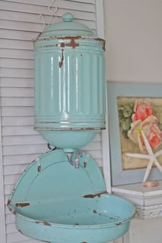 Antique French Enamelware Turquoise/Aqua Lavabo (Water Reservoir and Basin) This is truly a rare find! Sweet 19th C. antique French enamelware lavabo used in Madame's bedroom for washing hands. Water was placed in the reservoir (top section with lid), then a spigot for water to flow into the matching basin. These sets often hung on the back of a door in the boudoir. This charming lavabo set in turquoise with gold gilt stripes is made up of the lid, reservoir and basin (3 pieces).