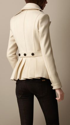 BURBERRY Beige Wool Cashmere Pea Coat A fitted pea coat crafted in a warm virgin wool and cashmere blend. The feminine silhouette features a three button martingale, wide revere collar and military-inspired regimental pleats. The clean design is complete with epaulettes and button-tab cuffs. Color: natural white