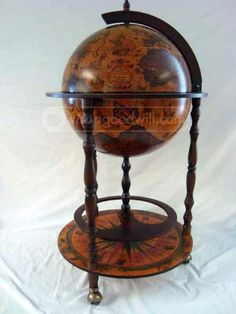 You know you want this!  http://www.shopgoodwill.com/auctions/Vintage-Portable-Globe-Bar-27010118.html #bar #globebar