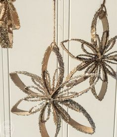 Reuse cardboard tubes to make pretty DIY snowflake ornaments for Christmas and the holidays! An easy craft project for both kids and adults.