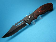 """The Rosewood Ripper  Tactical....A Great Affordable EDC (Every Day Carry ) A Very Nice Piece .....at a Very Nice Price  ! 440 SS Blacked Out & Sawback Blade 8"""" overall...... Also comes with a Safety & Pocket Clip. Finally A Knife You can Actually Use !!! At A Great Price !!   A Great Fishing Knife....use the sawtooth back as a Scaler... & If It falls Overboard...Your Not out 90 Bucks !!!"""