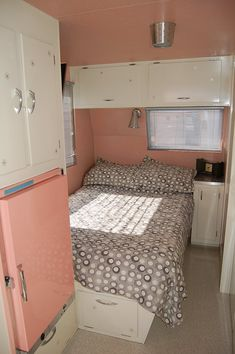 Love the pink fridge and the little starburst designs on the cabinets!
