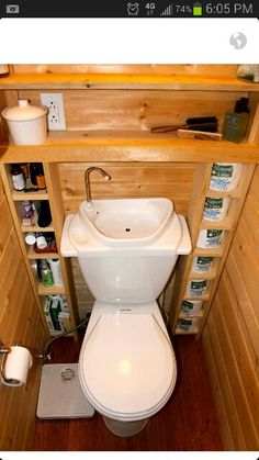 Tiny bathroom -toilet & sink combo and storage around it. This 1/2 bath could squeeze in most anywhere.