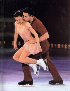 Ekaterina Gordeeva & Sergei Grinkov wearing romantic shades of red and pink. They were a fairy tale on ice.