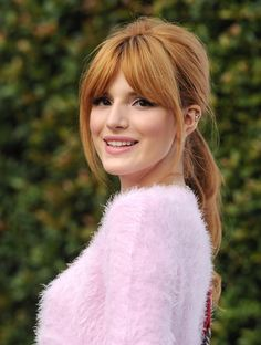 Bella Thorne channels Bridgette Bardot with this teased ponytail and fluffy pink top