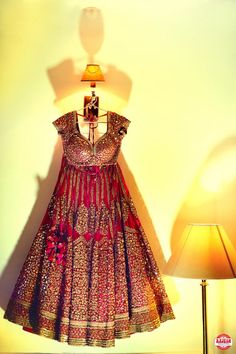 Bridal Lehengas - Marsala Colored Lehenga with Scattered Sequin Motif Work with Pom-poms | WedMeGood #wedmegood #lehengas #indianbride #marsala #indianwedding