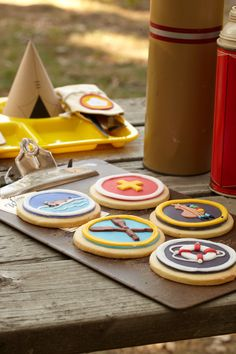 Scout Badge Cookies. Remember when you earned the music, archery or canoeing badge? Reward baby shower guests with their own badges in a sweet treat form.