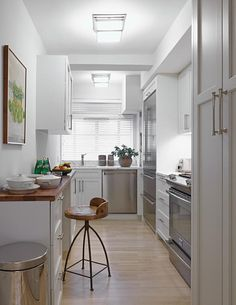 Excellent use of narrow kitchen space   Opus. AD