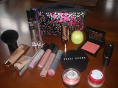 Gucci Flora Perfume Spray  Mariah M perfume Rollerball  181 MAC Brush  Body Shop Tinted Glow Enhancer #2  MAC Select Cover Up  Stila Kajal Topaz  MAC Ever So Rich Cremesheen Glass  MAC Boy Bait Cremesheen Glass  Bonnie Bell Lip Lites Cappuccino  Cover Girl Pillow Pink Lipstick  YSL Rouge Volupte #26 Tender Peach  EOS Lip Balm Honeydew  Illamasqua Rude Cream Blush  Bobbi Brown Bronzer  MAC Honey Bare Tender Tone  Body Shop Lip Butter  MAC Lingerie Lipstick