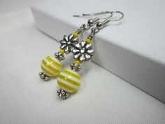 I made these earrings using glass beads, Czech glass seed beads, silver flower beads and spacer beads. Earrings dangle from surgical steel ear wire, approx Perfect for summer! These earrings have a matching necklace. Please check out the listing: Yellow Earrings, Beaded Earrings, Stud Earrings, Ear Jewelry, Gemstone Jewelry, Jewelry Making, Earring Tutorial, Matching Necklaces, Summer Jewelry