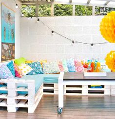 These deck benches appear made out of pallets! And they create a bit of storage space underneath, too...