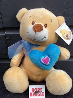 Pluche beer met een blauw hart en een strik, 30 cm