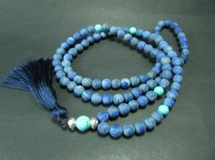 Mala made of 104 8mm natural matte lapis lazuli beads & 4 8 mm turquoise beads for marker beads. Guru bead made of one 10mm turquoise bead. A dark blue tassel added to the end. Mala Length: app. 34, Tassel + Guru bead Length: 5  Mala will send inside of a metal, ready to gift, box.  For faster delivery, you can select express shipping option when you check out.  Express Delivery Times:  Europe: 1-3 Days USA 2-5 Days Worldwide: 2-5 Days  If you have any question about this product please do…