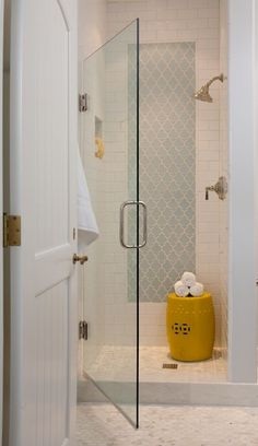 I like the accent tile wall and niche. Subway tile with grey grout love the shower door - Walker Zanger perfect