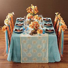 I like the color combination. #orange #blue #party #table