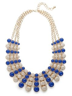 Delight in the two-tone allure of this graphic bib necklace. With that mix of metal and pavé finery, its plenty audacious and mesmerizing, too.