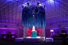 A Ribbon canopy...that is sure a way to spotlight the wedding cake