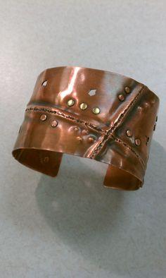 Solid copper cuff bracelet adorned with copper & brass rivets  #cassandramillardjewelry #oneofakind #handmadejewelry #copper