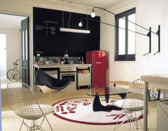 A SMEG fridge is a necessity. Along with the giant blackboard makes a really funky kitchen design.