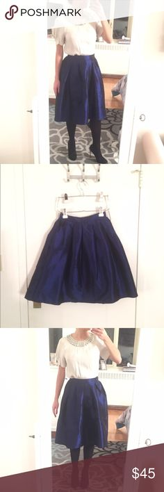 Midi Navy Blue Shimmering Skirt Midi Navy Blue Shimmering Skirt - Fits size XS-S (has elastic band on the back of waist) - Very Good Condition Skirts Midi