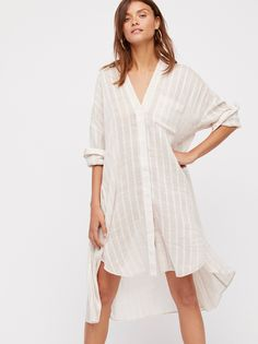 Sincerely Yours Maxi | Maxi tunic top featured in a lightweight gauzy fabric.    * Subtle stripe pattern   * V-neckline   * Hidden button closures down the front   * Hip pockets   * High low hem
