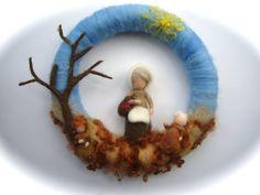 He encontrado este interesante anuncio de Etsy en https://www.etsy.com/es/listing/218967053/mother-earth-and-2-root-children-wreath