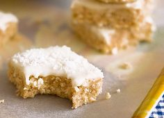 Easy no-bake lemon coconut slice. A biscuit coconut base with tangy lemon icing. No Bake Lemon Slice, Lemon Coconut Slice, No Bake Slices, Baking With Kids, Baking Tins, Sweet Recipes, Lemon Recipes, Yummy Recipes, Simple Recipes