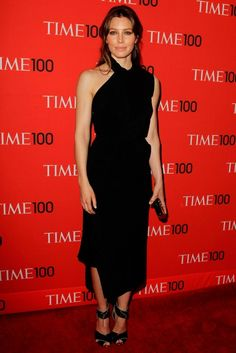 Jessica Biel at the Time 100 gala in New York, wearing a black asymmetric gown by Tom Ford, which she teamed with black heels and a matching clutch