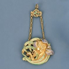 An Art Nouveau Coloured Enamel Pendant by Andre Rambour With green enamel leaf pendant hook, circa 1900