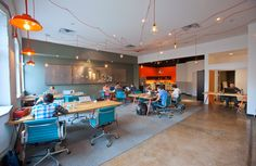 The public workspace at WELD. employee space - eating tables, pingpong/pool, yoga/exercise spot, kitchen area, climbing wall