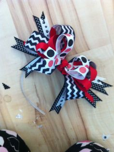 My 'Bigger the the Better' stand out bow on plastic headband! So fun..  Kreativekatiekonnect@gmail.com