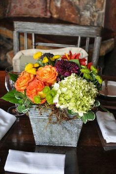 I've been asked to create a fall centerpiece for a ladies' tea for tomorrow.   The request is for a low centerpiece with colors coordina...