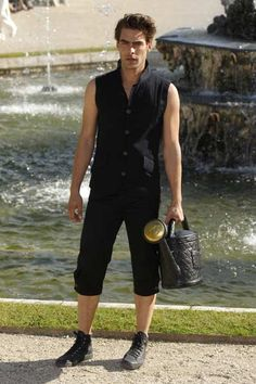 Model Jon Kortajarena presents a creation by German designer Karl Lagerfeld as part of his 2012-2013 Cruise collection show for French fashion house Chanel at the Chateau de Versailles (Versailles Palace), outside Paris May 14, 2012.