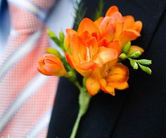 Orange Freesia wedding flower boutonniere, groom boutonniere, groom flowers, add pic source on comment and we will update it. www.myfloweraffair.com can create this beautiful wedding flower look.