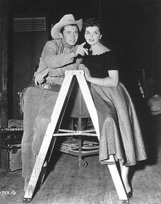 Audie Murphy poses with Lisa Gaye for a publicity photo during the filming of DRUMS ACROSS THE RIVER.