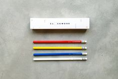 Pencil sets that each consisted of 4 grey pencils in base colours red, yellow, blue and white, all packaged inside a custom made box base with a cool #sleeve design. #corporate #corporatestationery #stationery #greybox #grey #box #whiteandblueandregandyellowpencil #white #blue #red #yellow #pencil #cool #chic For more follow the link below. How To Make Box, Blue And White, Yellow, Stationery Design, Pencil, Base, Colours, Cool Stuff, Chic