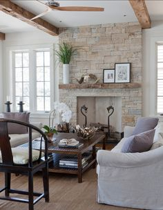 "Wettling Architects. The stone is ""South Bay quartzite"". The stone is 84″ wide. The opening is 48″ wide.  This is a rumford fireplace."