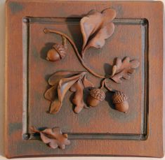hand sculpted tiles  from kristirowland.com_ iron oxide acorn