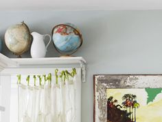 I want a globe collection ! Put a shelf above a door or window to make room for a collection. I love the shower curtain window treatment