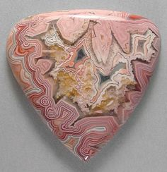 "Laguna Lace Agate (Mexico);  can be used to help one to reach extremely high physical levels.  It also helps one to understand the plan of the ""perfect human""-providing insight to the many paths which are available to take one to the heights of awareness.  It allows one to laugh, heartily, and to comprehend the games of this world."