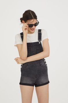Check this out! Short bib overall shorts in washed stretch denim. Bib pocket, adjustable suspenders, and buttons at sides. Mock fly, mock front pockets, regular back pockets, and sewn cuffs at hems. - Visit hm.com to see more.