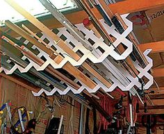 Garage Ceiling Lattice. Hangs scrap sections of plastic lattice to store everything from lengths of molding to fishing poles. Because of the open design of the lattice, you can quickly see the items stored overhead and has easy access to them. http://hative.com/clever-garage-storage-and-organization-ideas/