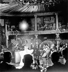 """A radiant Dorothy Dandridge at Cafe de Paris in London. Her sold-out engagement prompted newspapers to write headlines like """"Singing `Sexation' Dandridge Sells Out Cafe de Paris"""" and """"London Under Dandridge Spell."""""""