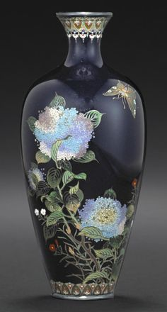 A small cloisonné enamel vase by Hayashi Kodenji, late 19th/early 20th century. Of baluster form and worked in gilt and silver wire with a multicolor enamel design of a butterfly hovering above flowering hydrangea and wild pinks silhouetted against a mirror black ground, the neck and foot encircled by bands of jeweled lappets, with silver rims, the base with the company mark. 4 7/8in (12.4cm) high. Bonhams 2014 - $11,250