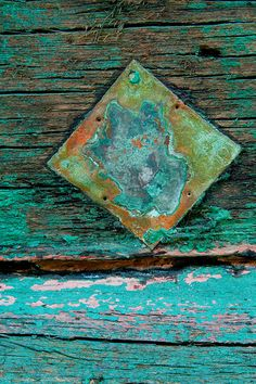 weathered paintwork and rusted plate