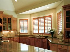 Gorgeous shutters stained to match the cabinets.
